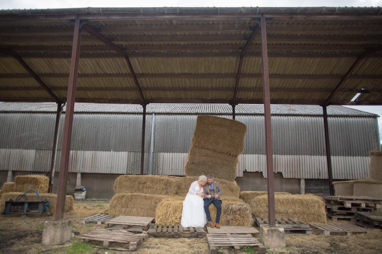 Bride Bridal Dress Gown Charlotte Balbier Long Sleeve V Neck Tweed Three Piece Groom Waistcoat Mismatched Pocket Square Barn Haystack Hay Bales Quirky Rustic Farm Wedding https://ragdollphotography.co.uk/