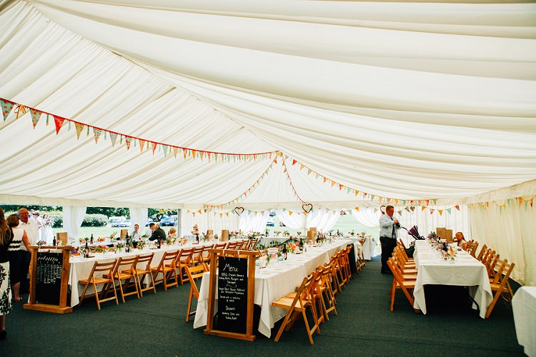 Marquee Bunting Eco Friendly Floral Filled Wedding http://kellyjphotography.co.uk/