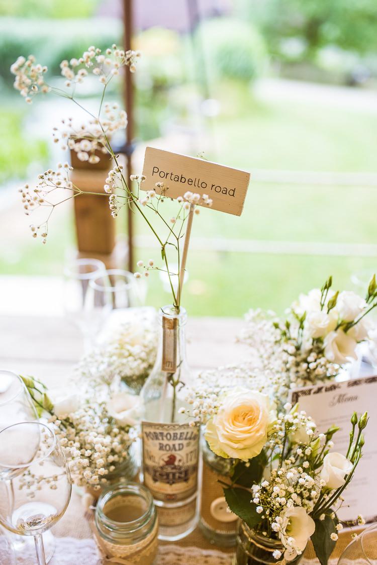 Bottle Jar Flowers Decor Centrepiece Table Name Laid Back Summer Garden Party Wedding Stretch Tent http://joemallenphotography.co.uk/