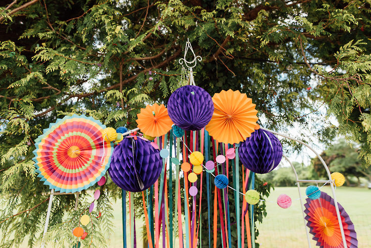 Ceremony Backdrop Ribbons Pinwheels Pom Poms Alternative Colourful Outdoor Humanist Village Hall Wedding http://www.chebirchhayesphotography.com/