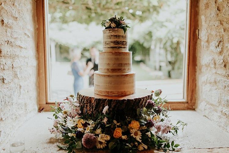 Semi Naked Cake Flowers Log Stand Beautiful Simple Relaxed Barn Wedding http://jenmarino.com/