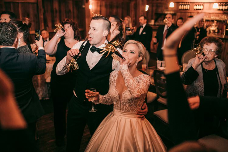 Happy New Year Foil Trumpet Bride Groom Barn Party | Festive Glamour Christmas New Years Eve Wedding http://www.stevendrayimages.com/