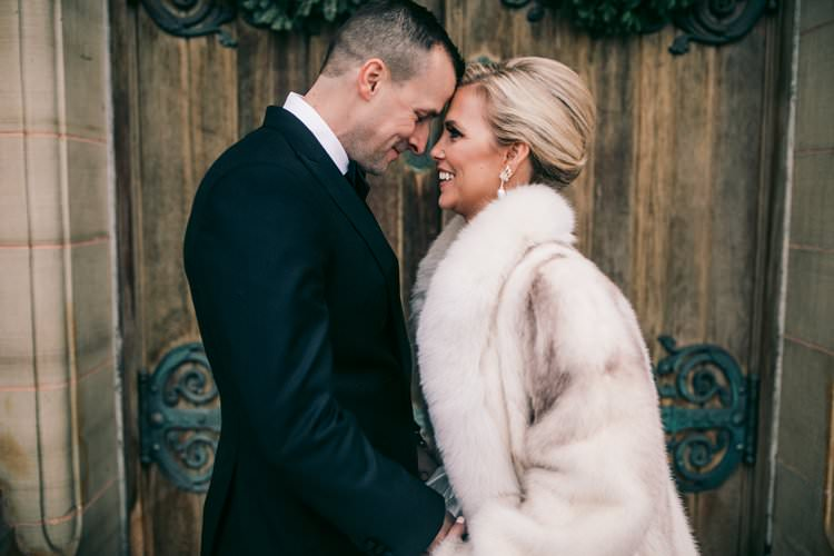 Winter Couple Bride Groom Kiss Fur Coat Barn Navy Suit | Festive Glamour Christmas New Years Eve Wedding http://www.stevendrayimages.com/