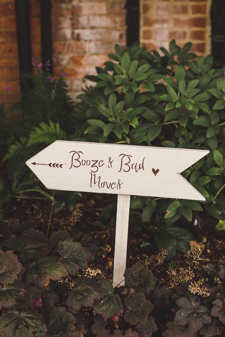 Wooden Festival Sign Post Booze & Bad Moves DIY Whimsical Romantic Barn Wedding http://kirstymackenziephotography.co.uk/
