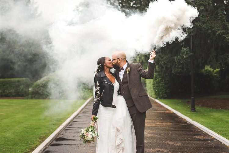 Bride Bridal Maggie Sottero Long Sleeved Lace Dress Sweetheart Leather Jacket Groom Brown Tweed Three Piece Waistcoat Bow Tie Smoke Bomb Whimsical Romantic Barn Wedding http://kirstymackenziephotography.co.uk/