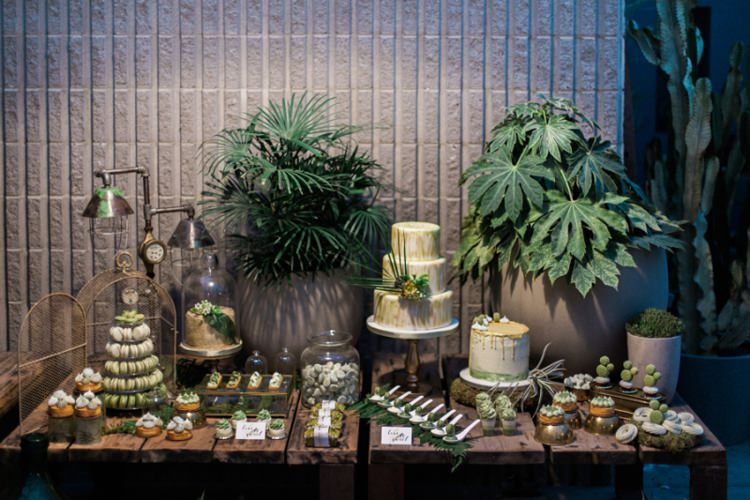 Green Foliage Dessert Table Cake Macaroons Leaves Wood Vases Conservatory | Greenery Botanical Wedding Ideas https://lisadigiglio.com/
