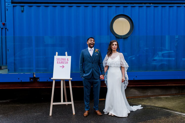 Bride Bridal Groom Couple Portrait Sign Direction Easel Bright Very Colourful Quirky Fun City Wedding London http://www.babbphoto.com/