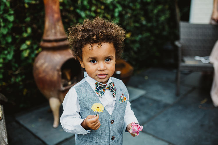Page Boy Floral Bow Tie Waistcoat Colourful DIY Floral Luxe Barn Wedding http://www.joemather-photography.co.uk/