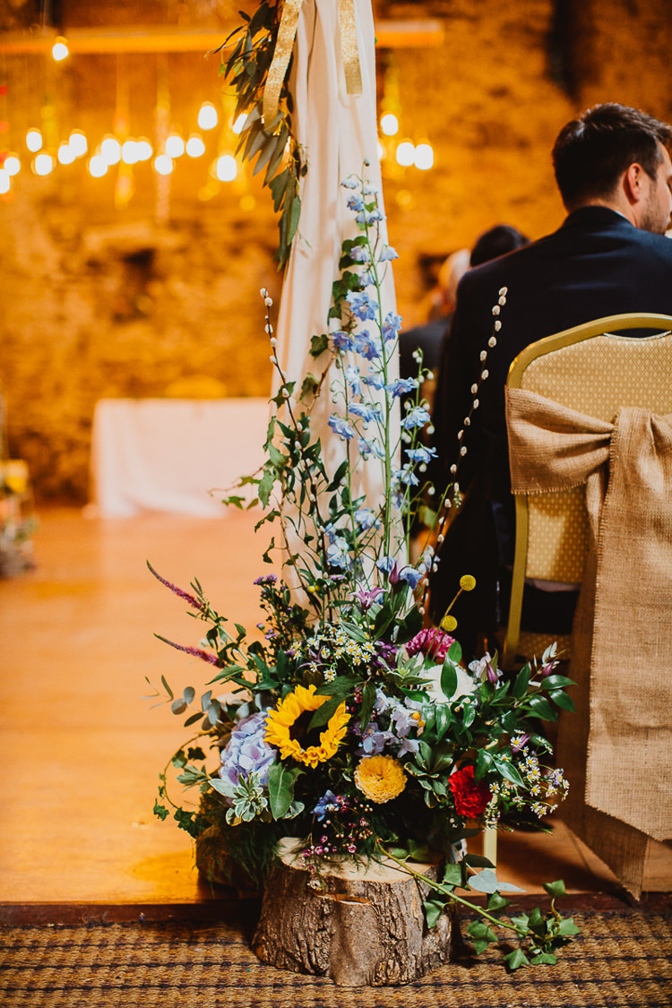 Flowers Log Slice Ceremony Summer Colourful DIY Floral Luxe Barn Wedding http://www.joemather-photography.co.uk/