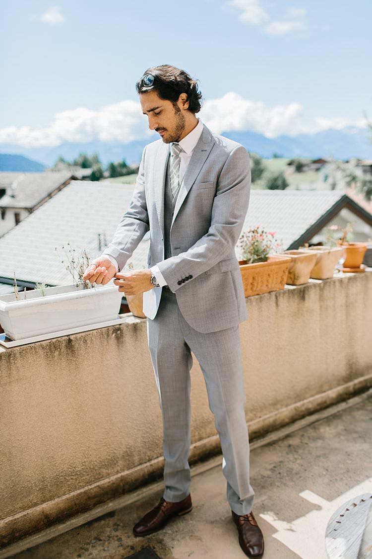 Destination Grey Suit Groom Cufflinks Stylish Green Tie Summer | Romantic Castle Switzerland Wedding http://kbalzerphotography.com/