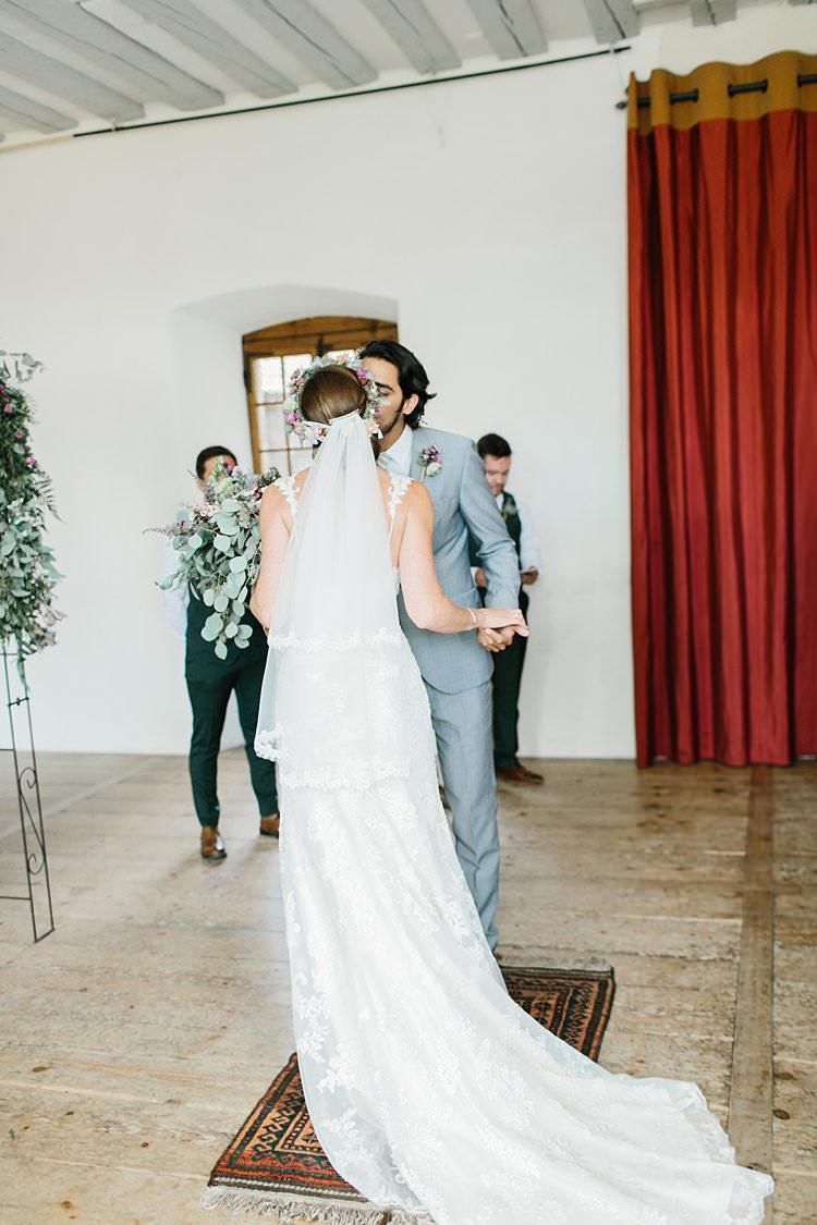 Destination Ceremony Bride Short Veil Groom Kiss Wild Natural Bouquet Rug | Romantic Castle Switzerland Wedding http://kbalzerphotography.com/