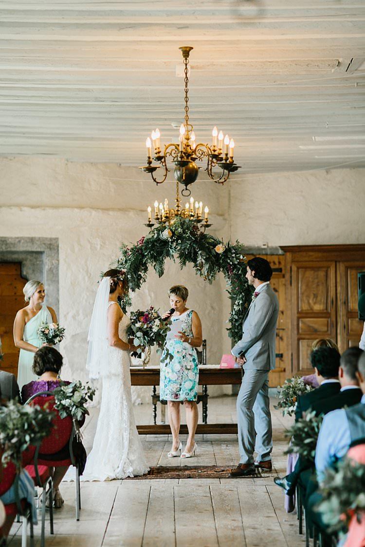 Destination Ceremony Bride Groom Aisle Wild Natural Bouquet Chandeliers Floral Arch Celebrant | Romantic Castle Switzerland Wedding http://kbalzerphotography.com/