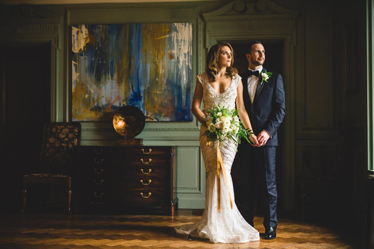 Bride Bridal Veil Dress Gown Embellished Fishtail Moss Bros Groom Navy Dinner Jacket Tuxedo Bow Tie Bouquet Ribbon Gold Sequins Marble Greenery Vintage Glamour Wedding https://www.tobiahtayo.com/