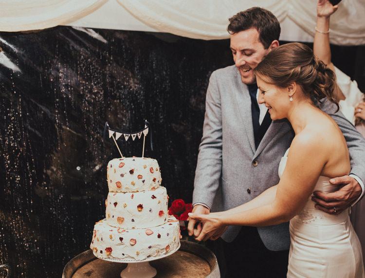 Cake Cutting Buttercream Meringue Petal Bride Bridal Dress Gown Suit Supply Groom Mismatched Grey Blue Jacket Three Piece Waistcoat Rustic Country Fun Autumn Farm Wedding http://natalyjphotography.com/