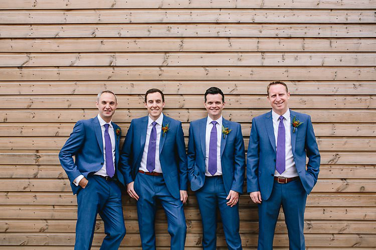 Blue Suits Purple Ties Groom Groomsmen Tropical Countryside Tipi Wedding https://parkershots.com/