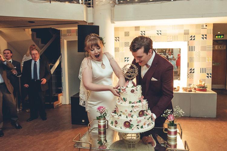 Bride Groom Cutting Fun Homemade Cake DIY Three Tier Sugar Flowers | Greenery Burgundy City Autumn Wedding http://lisahowardphotography.co.uk/