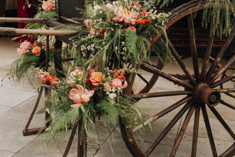 Flower Arrangement Coral Peonies Cart Orange Country Barn Wedding http://www.meganduffield.com/