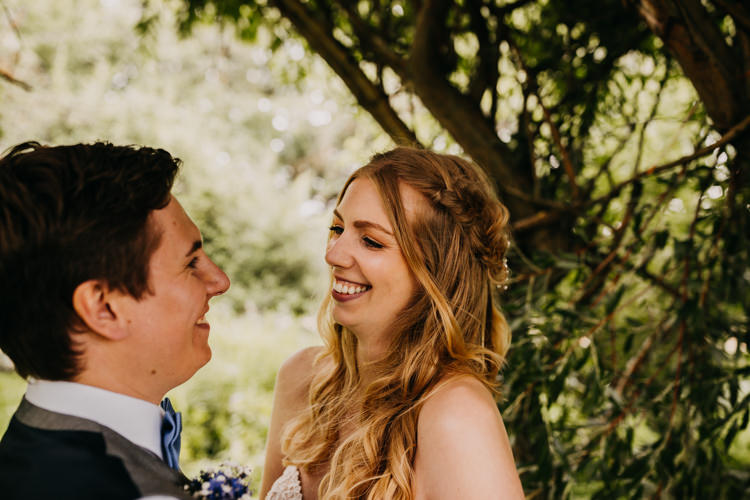 Intimate Bride Groom Outdoors Field Woodland Laughing   Rustic Relaxed Cornflower Blue Barn Wedding http://www.peterhugophotography.com/