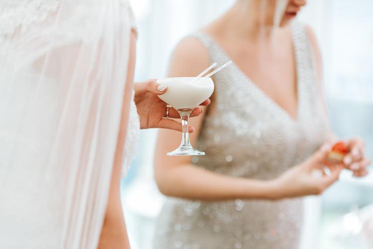 Reception Cocktails Bride Bridesmaid White Sequin Glitter | Glitter Dinosaurs City Wedding https://struvephotography.co.uk/