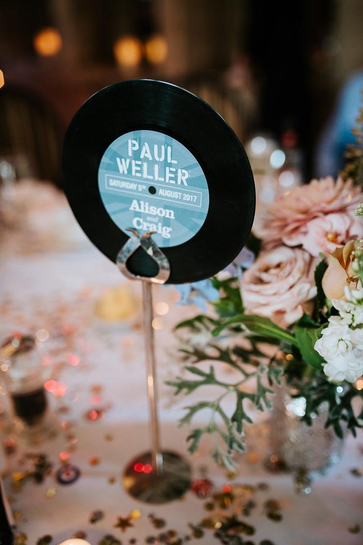 Music Record Table Name Vinyl Decor Blush Pastel Flower Centrepiece | Glitter Dinosaurs City Wedding https://struvephotography.co.uk/
