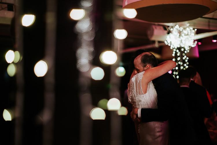 Bride Groom First Dance Embrace Lights Urban Venue | Glitter Dinosaurs City Wedding https://struvephotography.co.uk/
