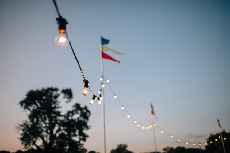 Festoon Lights Flags Festival Bohemian Glamping Wedding https://theshannons.photography/