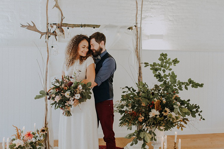 Branch Antler Wooden Arch Backdrop Flowers Arbour Ceremony Banquets Bonfires Autumn Wedding Ideas https://lolarosephotography.com/