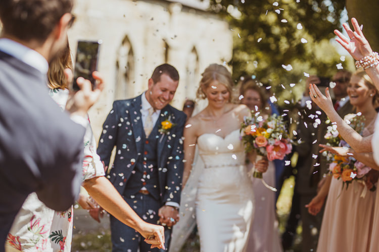 Bride Bridal Sweetheart Neckline Gown Dress Tweed Three Piece Waistcoat Groom Navy Multicolour Colourful Bouquet Confetti Rural Clifftop Tipi Wedding https://www.njphotographic.co.uk/