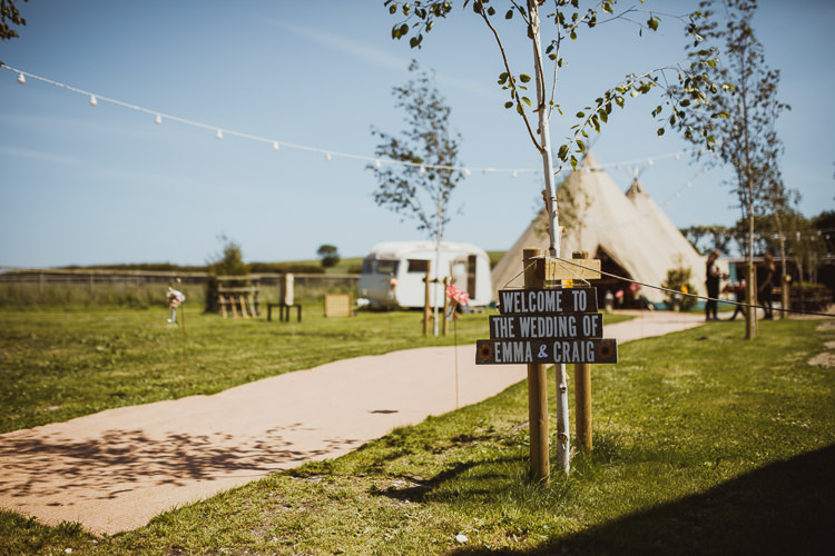 Welcome Sign Post Rustic Homemade Pallet Direction Rural Clifftop Tipi Wedding https://www.njphotographic.co.uk/