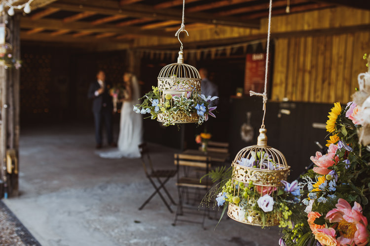 Gold Sprayed Birdcage Floral Flower Hanging Multicolour Colourful Rural Clifftop Tipi Wedding https://www.njphotographic.co.uk/
