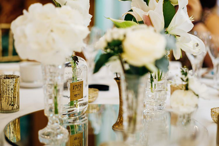White Flowers Bottles Mirror Table Stylish Country House Rave Wedding http://www.mariannechua.com/