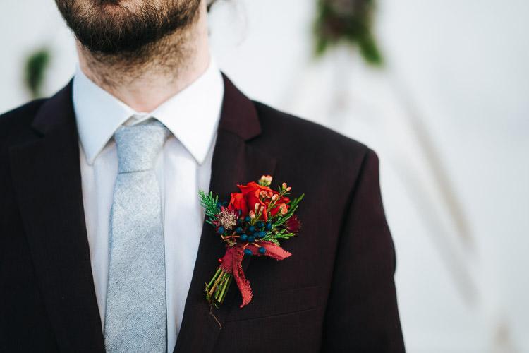 Flowers Greenery Folliage Rose Buttonhole Groom Red Green Winter Wonderland Wedding Ideas http://www.angelawardbrown.com/