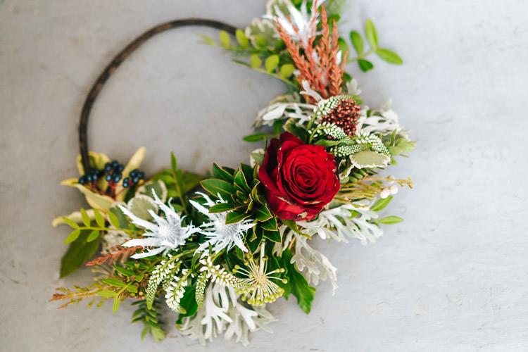 Flowers Greenery Folliage Rose Hoop Red Green Winter Wonderland Wedding Ideas http://www.angelawardbrown.com/