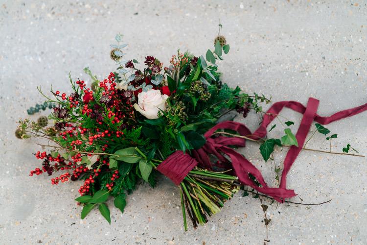Flowers Greenery Folliage Rose Bouquet Ribbon Bride Bridal Red Green Winter Wonderland Wedding Ideas http://www.angelawardbrown.com/