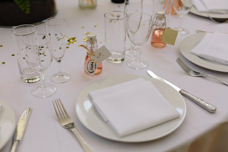 White Simple Tablescape Glitter Pink Rhubarb Gin Mini Bottle Favour Gold Glitter | Modern Tropical Gold Urban Wedding https://www.christinewehrmeier.com/