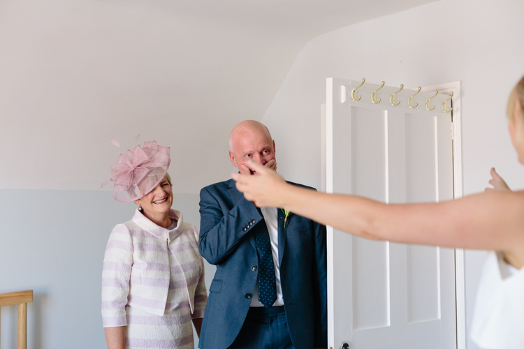 Bride Mother Father Embrace Hug First Look Emotional Happy | Modern Tropical Gold Urban Wedding https://www.christinewehrmeier.com/