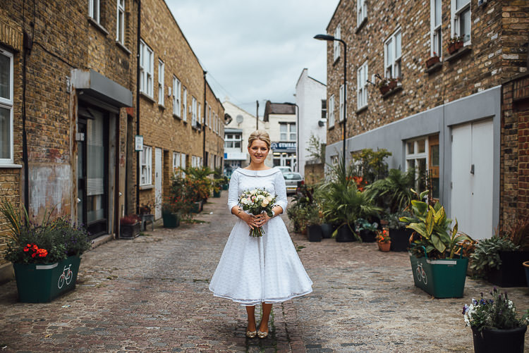 Bride Bridal Candy Anthony Polka Dot Peter Pan Collar Tea Length Bouquet Chic Relaxed London Pub Wedding https://theshannons.photography/