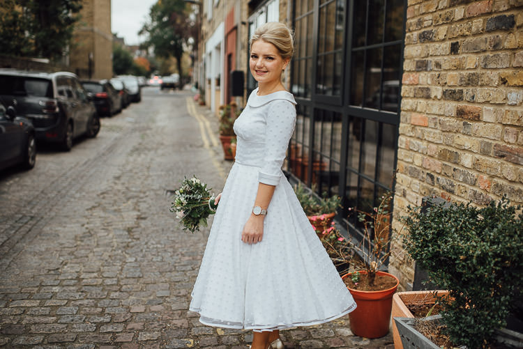 Bride Bridal Candy Anthony Polka Dot Peter Pan Collar Tea Length Dress Gown BouquetChic Relaxed London Pub Wedding https://theshannons.photography/