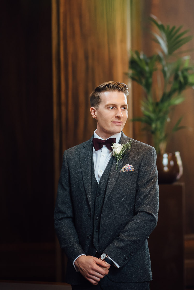Groom Grey Tweed Suit Burgundy Bow Tie Three Piece Waistcoat Pocket Square Chic Relaxed London Pub Wedding https://theshannons.photography/