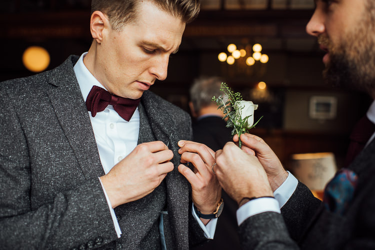 Groom Style Tweed Grey Three Piece Suit Waistcoat Bow Tie Burgundy Pocket Square Buttonhole Chic Relaxed London Pub Wedding https://theshannons.photography/