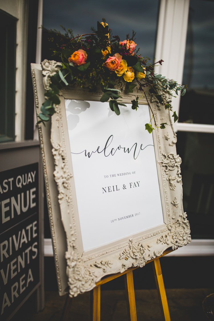 Welcome Sign Board Frame Foliage Floral Flowers Colourful Fun Cosy Rainy Sea Wedding http://www.livvy-hukins.co.uk/