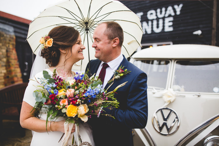 Groom Navy Suit Bride Bridal Floor Length T Shirt Neckline Short Sleeves Multicolour Wild Flower Bouquet Umbrella Colourful Fun Cosy Rainy Sea Wedding http://www.livvy-hukins.co.uk/