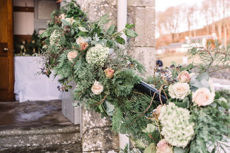 Foliage Floral Flower Garland Bannister Peach Roses Enchanted Magical Snowy Wedding https://www.thegibsonsphotography.co.uk/