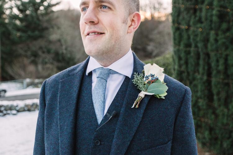 Tweed Groom Three Piece Waistcoat Buttonhole Blue Tie Enchanted Magical Snowy Wedding https://www.thegibsonsphotography.co.uk/