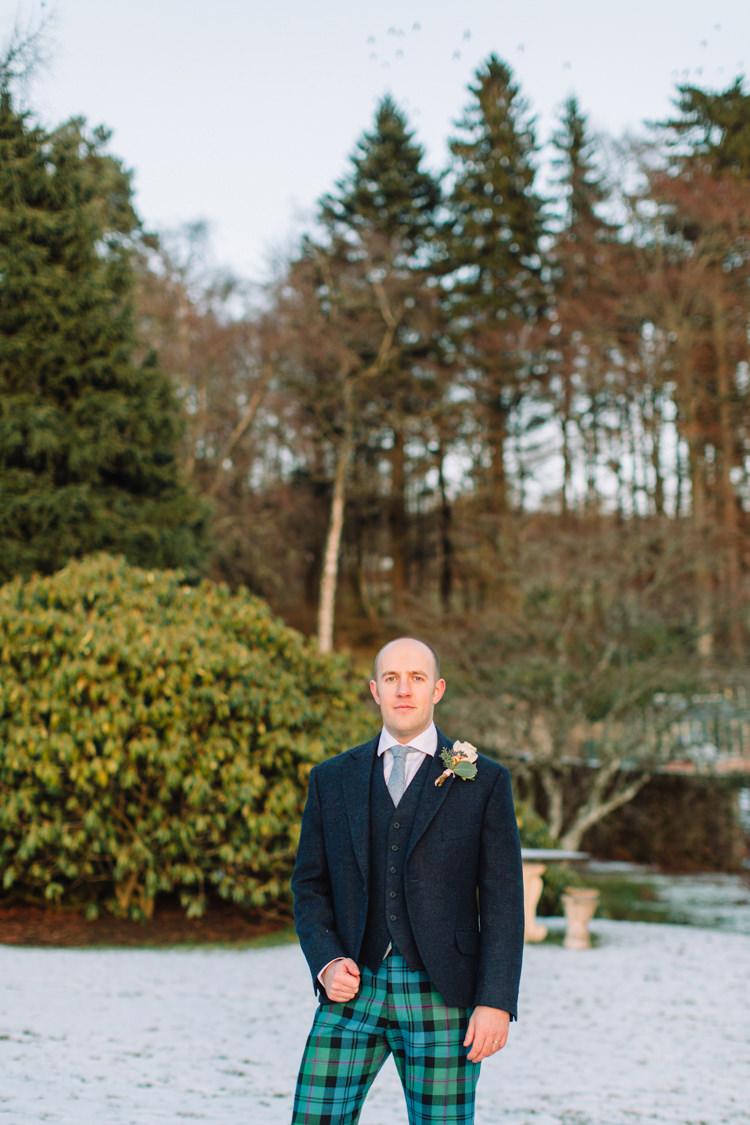 Tartan Trousers Groom Tweed Three Piece Waistcoat Enchanted Magical Snowy Wedding https://www.thegibsonsphotography.co.uk/