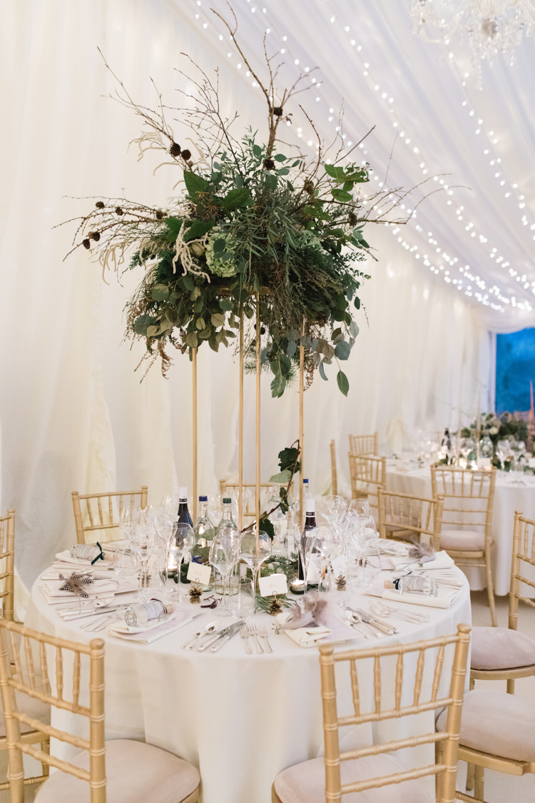 Table Setting Pedestal Arrangement Foliage Twigs Tall Enchanted Magical Snowy Wedding https://www.thegibsonsphotography.co.uk/