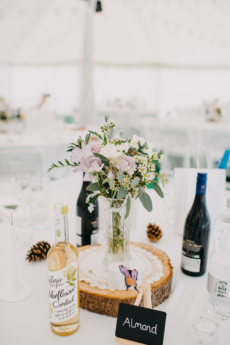 Table Centre Wood Slice Tree Flowers Floral Vase Magical Woodland Family Wedding http://photographybyclare.co.uk/