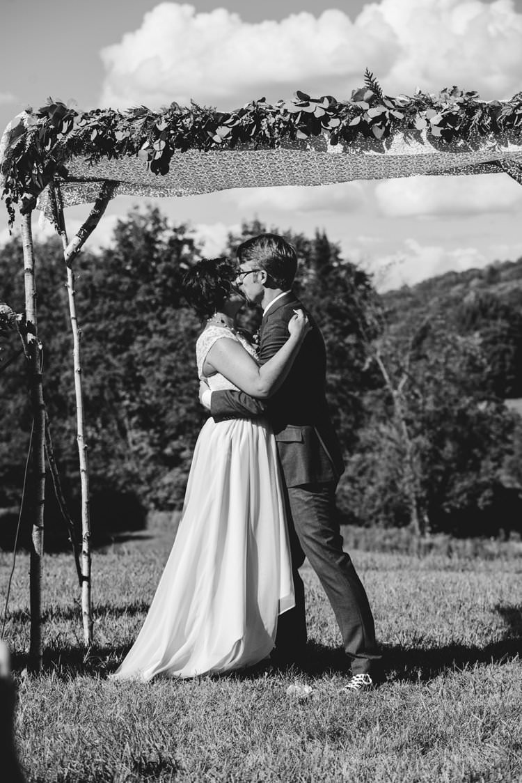Outdoor Field Forest Wild Nature Marquee Tipi Bride Groom Kiss Floral Arch Ceremony Aisle | Breathtaking Secluded Back Garden Open Sided Tent Wedding Vermont https://kickasscouples.com/