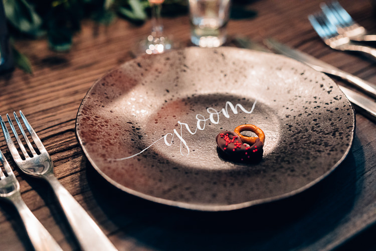 Place Name Setting Black Plates Calligraphy Edgy Raw Industrial Barn Wedding Ideas Greenery Festoon Lights http://www.two-d.co.uk/