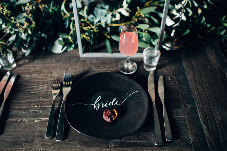 Table Tablescape Flowers Black Plates Calligraphy Swag Garland Edgy Raw Industrial Barn Wedding Ideas Greenery Festoon Lights http://www.two-d.co.uk/